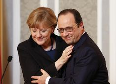 Germany's Chancellor Angela Merkel embraces France's President Francois Hollande during a meeting with the media after peace talks on resolving the Ukrainian crisis in Minsk, Belarus, February 12, 2015. REUTERS/Grigory Dukor