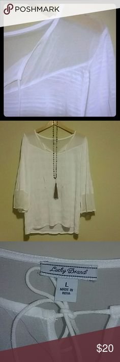 Lucky Brand hippie top This is a super awesome soft white top that has a sheer neckline it also has a tie at the neckline, there is also a sheer fabric at the sleeves, the sleeves are three-quarters of length and it is a size large it seems to run pretty big . Great condition worn one time Lucky Brand Tops Blouses