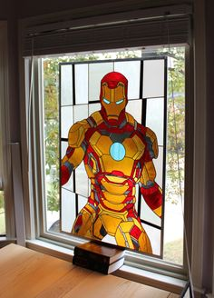 """Video Game and Superhero Stained Glass Panels - The piece of glass(top image) shows off Iron Man's armor in amazing detail. """"R. Evan Daniels spent over 100 hours creating it with approximately 334 pieces of glass, 275 feet of copper foil and 5 rolls of solder. """""""