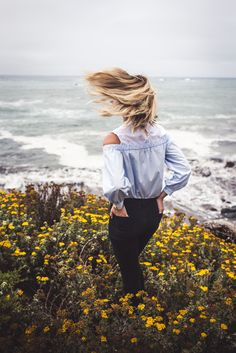 WILD COASTLINES Liz Cherkasova at Late Afternoon: off shoulder collared blue shirt, denim pants