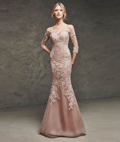 LAURINA- Tulle and lace mermaid dress. Sheer effect bodice and sleeves decorated with appliqués front and back.