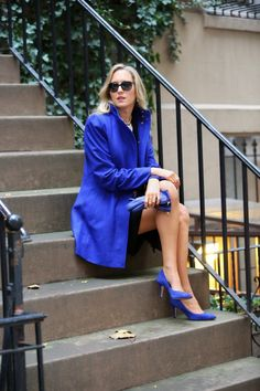 blue coat with suede shoes