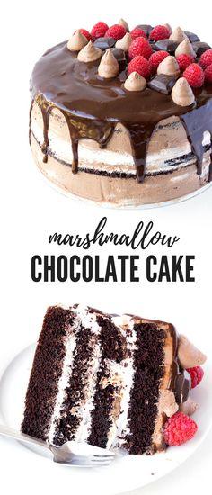 This gorgeous Raspberry Marshmallow Chocolate Layer Cake is AMAZING. Chocolate cake with layers of marshmallow frosting, creamy chocolate frosting and dark chocolate ganache. Recipe from sweetestmenu.com #cake #marshmallow #chocolate #raspberries #dessert