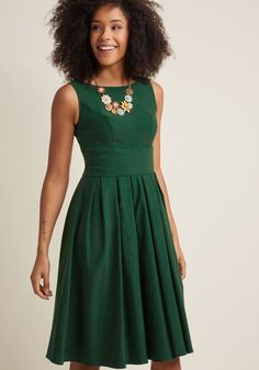 <p>With the confidence you exude while clad in this green midi dress, it appears as though sporting sophisticated style is your calling! Classic from its tailored bodice and belted waistline, down to its skirt full of crisp pleats, this darling number verifies your elegant finesse.</p>