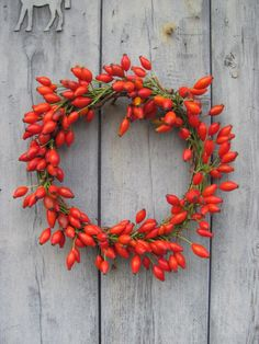 Rose hip wreath by The Blue Carrot, UK. Gardenista
