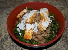 "Our neighborhood vegetarian restaurant, The Wild Cow, makes this awesome beans and greens bowl that you can get ""buffalo style,"" topped with buffalo tofu and vegan ranch. It's one…"