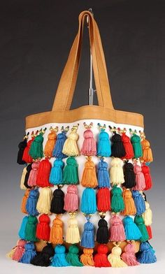 Mara Hoffman way cute,could do crochet with single colored tassels and loom beaded strap..yum