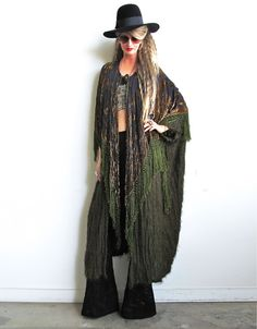 To-die-for avant garde duster!  Amazing shaggy moss knit  layered with a stunning two toned amber on black velvet burnout shawl with moss colored fishnet fringe!  Oversized cut creates a dramatic and gorgeous drape.  There's a single large wooden button closure.  Incredibly comfortable to wear...a chic and effortless piece.  Free SizeOverall length is 43""