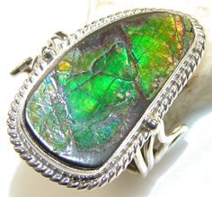 $88.25 Secret Island!!!! Ammolite Sterling Silver ring s. 12 at www.SilverRushStyle.com #ring #handmade #jewelry #silver #ammolite