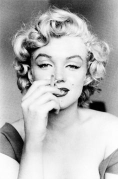 """I know what, I have to learn to smoke a cigarette for my next picture. You can take pictures of me practicing."" - Marilyn"