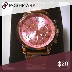 Brand New Geneva Pink Watch Very Pretty brand new Geneva watch. It is rose gold stainless steel. The face is pink and gold. Still has plastic protecting the band. This watch fits a 8 inch wrist perfectly. Any smaller may have to see if you can remove link. Watch Jewelry