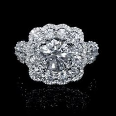 Recently Purchased Engagement Ring: Client chose a 2.00 carat certified round brilliant cut center stone set within product #6540, a diamond 18k white gold halo setting 1.66ctw.