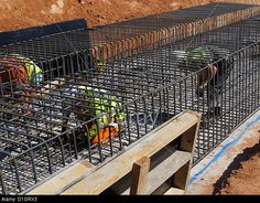 Steel fixer tying reinforcement bars in a bridge foundation base construction building site civil engineering UK Stock Photo Uk Images, Construction Design, Civil Engineering, Vermont, Civilization, Wine Rack, Bridge, Foundation, Base