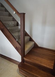 Walnut Staircase with Glass Balustrade