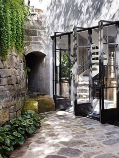 steel doors leading onto a stone patio