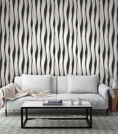 Quando usamos móveis modernos, o uso de papel de parede para compor a decoração tende a valorizar tais móveis, destacando-os na decoração. O papel de parede com listras onduladas e detalhes em relevo da Bobinex é uma boa opção para esses casos, como podemos ver na foto, valorizando o sofá branco.