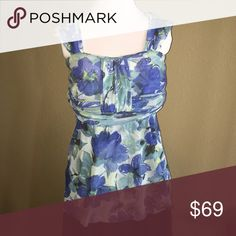 Anthropologie - Sweet Pea Floral Gauzy Tank Stretchy Nylon Mesh. Two Layers of fabric. Cool to wear even in summer but not too sheer. Empire waist with waist band. Great condition. No holes, stains, or other flaws.  Perfect for tropical vacation or preparing for summer! Anthropologie Tops Tank Tops