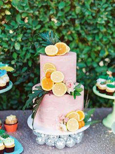 Tropical desert inspired desserts with succulent icing cupcakes, cocktail umbrella toppers, and a two tier pink cake covered in cut orange and lemon slices and greenery. Riviera Palm Springs Wedding by Cavin Elizabeth Photography Purple Wedding Cakes, Elegant Wedding Cakes, Retro Wedding Cakes, Rustic Wedding, Wedding Vendors, Wedding Tips, Wedding Planning, Wedding Bridesmaids, Wedding Bouquets