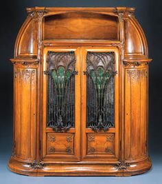 'AUX ALGUES', A CARVED MAHOGANY, CAMEO GLASS AND WROUGHT-IRON CABINET  LOUIS MAJORELLE, CIRCA 1906