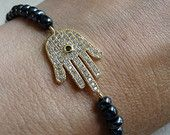 Gold Hamsa Hand Charm with navy beads £22.50