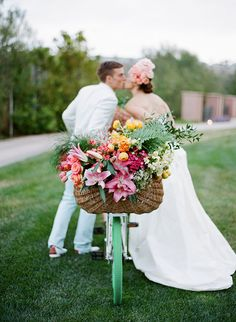 Bicycle with a basket of flowers | Photo by Jose Villa #shabbychicwedding