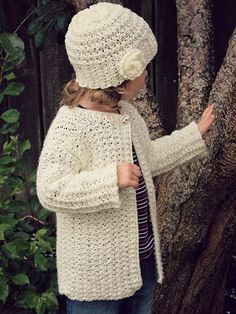 Made using a DK-weight yarn, this pretty cardigan and hat combination is perfect for a chilly day. Pattern includes written instructions and close-up working photos. Cardigan is written in size: 1 (2, 3, 4, 5, 6, 7, 8, 10, 12) year(s) and uses 550 (6...