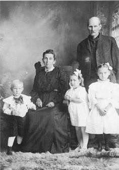 My Great-Grandfather, William Porter Robinson 1848-1930 & his wife Margaret Emaline Kennedy Robinson 1854-1936 - They are pictured with three of their grandchildren; my father, William David Robinson 1903-1957, standing on the left; Pearl A Rather, 1904-1977, in the center & Nellie Mae Robinson 1899-1994, standing on the right.