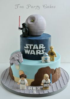 - 6 and 10 inch fondant covered cakes with fondant figures with hand painted details. The Death Star is a styro ball covered in fondant and the light sabers are lollipop stick that were cut down to size and covered with some luster dust.
