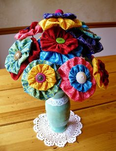 A super cute yo yo flower bouquet.  The tutorial here: http://www.flightofthepook.com/2011/07/diy-yo-yo-bouquet.html