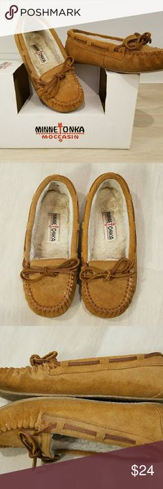 Minnetonka Britt Trapper Moccasin Slipper MINNETONKA MOCCASIN Britt Trapper Color Cinnamon Size 5 M  Rest comfortably indoors or out in the leather moccasin style Minnetonka Britt Trapper Slipper.? Features include a decorative leather ribbon that ties in a bow, rustic stitching at toe and heel seams, and faux fur lining with a cushioned insole.  Suede leather upper with round moc toe Decorative leather ribbon weaves, padded collar, cushioned insole Traction grippy indoor/outdoor outsole…
