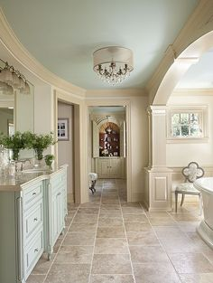 Ceiling and cabinets are the same color.  Walls are neutral. Marble - complex, Traditional, Free Standing, Raised Panel, Undermount, Master, Chandelier