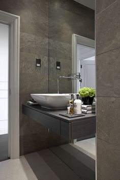 floating vanity shelf with single drawer and counter top mounted basin | wall tap mounted on mirror | soft taupe and grey palette | contemporary bathroom || Boscolo Ltd UK