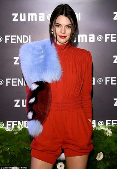 So high-fashion: She afforded the effortlessly chic one-piece a contrasting edge with a funky fur stole thrown over one shoulder