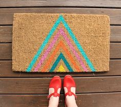 Your welcome mat can say hello to your guests before you even open your door (Plus, it will hopefully save you from a mess inside). Whether you're on a budget or just feel like getting crafty, you can create something unique with a really basic and affordable mat. Here are 10 ways to welcome guests with a custom touch.