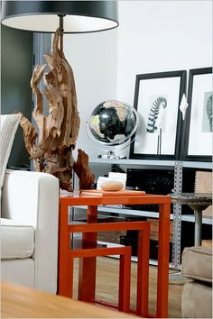 "The vintage driftwood lamp was $1,700 at Gray Gardens, an antiques store in Stamford, Conn. It sits on a set of orange lacquer nesting tables that were $325 at West Elm. (West Elm no longer carries them, but it does have a set of two parallel nesting tables in cinnabar, for $199, which would work as an alternative.) ""Design can be mass market,"" Mr. Groves said.    http://www.nytimes.com/slideshow/2009/08/05/garden/20090806-easthampton-slideshow_6.html#"