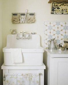 vintage style laundry room w utility sink and mosaic backsplash