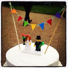 Lego wedding cake topper! Super cute with bunting too.