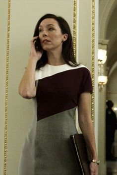 Assistant Minority Whip Senator Jackie Sharp (Molly Parker) in House of Cards, Season 3, Episode 9. Fendi Silk and Tweed Colorblock Dress. Silver Continent Fine Jewelry Diamond Micro Pave Oval Stud Earrings #silvercontinent #fendi