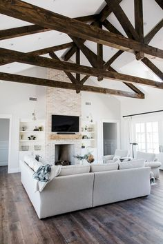 30 Rustic Farmhouse Living Room Design and Decor Ideas for Your Home. 30 Rustic Farmhouse Living Room Design and Decor Ideas for Your Home. Room Makeover, Rustic Ceiling Beams, Farmhouse Decor Living Room, Modern Farmhouse Living Room Decor, Fireplace Surrounds, Room Remodeling, House Interior, Rustic Living Room, Rustic House