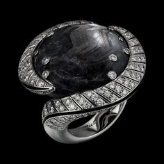 "CARTIER. ""Mamba Snake"" Ring - white Gold, one 59.13-carat cabochon-cut black Sapphire from Kenya, black lacquer, brilliant-cut Diamonds. Étourdissant Cartier 2015 High Jewellery Collection"
