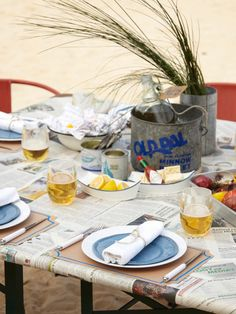 It wouldn't be summer without an outdoor lobster bake. Cover the table with newspaper for an inexpensive way to bring festivity to your party. Shellfish is so vivid that you don't need a ton of decor to create an appealing yet casual table setting. Add some simple dinnerware to complete the look without going over the top. Photo courtesy of Pottery Barn