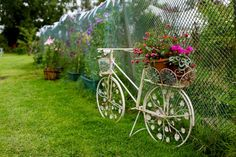 Bicycle decoration - a very pretty cake and flower filled wedding | uk wedding blog