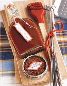 """Nice gift """"basket"""" idea: skewers, bottle for homemade sauce, silicon brush, grilling planks, etc -- and each one of these items is available at Crate&Barrel. Add thematic tea towel or hot pad and apron, season/rub, etc."""