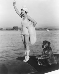 Gloria Swanson, in 1917. And the dog one of her co-stars, Teddy.