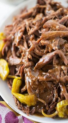 Mississippi Roast involves a slow cooker, five simple ingredients, zero effort and 100% dinner and leftover satisfaction.