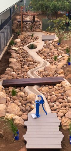 Wet and Dry Creek bed with bridges and a hand water pump. - Shelby Unfred - Wet and Dry Creek bed with bridges and a hand water pump. Wet and Dry Creek bed with bridges and a hand water pump. Water Playground, Natural Playground, Backyard Playground, Backyard Kids, Playground Ideas, Children Playground, Outdoor Play Spaces, Outdoor Fun, Backyard Playset