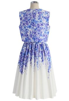 This Wisteria dream twinset dress with purple-hued flowers that hang from the shoulders down onto a white skirt.  - Wisteria flower pattern, split hem on top, sleeveless design,  keyhole cutout with button to reverse, concealed back zip & hook, not lined, 100% polyester, handwash.  ||| w3. chicwish.com/wisteria-drea-twinset-dress. html |||