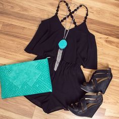 Black romper and shoes, blue necklace