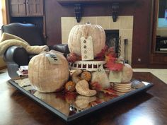 display decoupaged seasonal items...in this case, pumpkins and gourds, on a mirrored tray and at different levels (I used a cake stand) to create interest.
