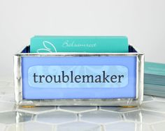 """Need a place to put your business cards? This bright, whimsical card holder easily holds 50-100 regular business cards and will add fun and color to your desk.  I made this stained glass business card holder from blue stained glass. All of the pieces are hand cut and hand assembled in my home studio. I use a technique known as """"plating"""" to secure the paper label between two pieces of glass where it is protected from wear and tear.  This card holder is 4 inches (10 cm) long and each side…"""